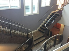Double staircase leading to the workout room